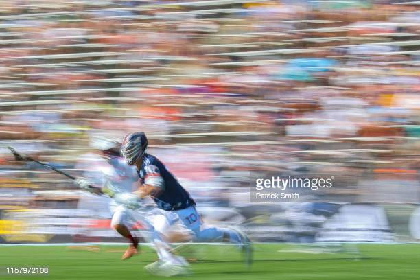 Stephen Kelly of Archers dodges past a Chaos defender as he clears the ball in the first half during week four of the Premier Lacrosse League at...