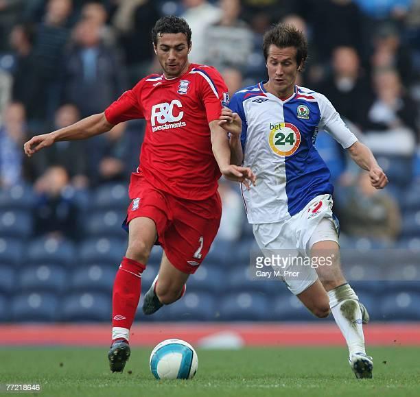 Stephen Kelly of Birmingham City and Morten Gamst Pedersen of Blackburn Rovers in action during the Barclays Premier League match between Blackburn...