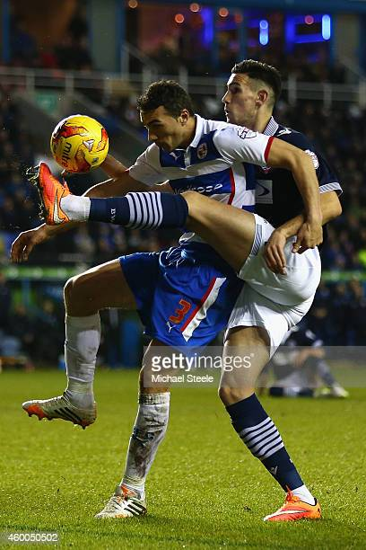 Stephen Kelly of Reading is challenged by Conor Wilkinson of Bolton Wanderers during the Sky Bet Championship match between Reading and Bolton...