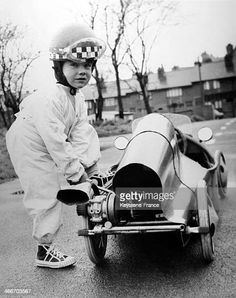 Stephen Kendrick makes a minor adjustement to the racing car built by his grandfather before testing on April 4 1962 in United Kingdom