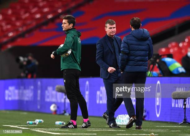 Stephen Kenny, Manager of Republic of Ireland interacts with Gareth Southgate, Manager of England after the final whistle during the international...