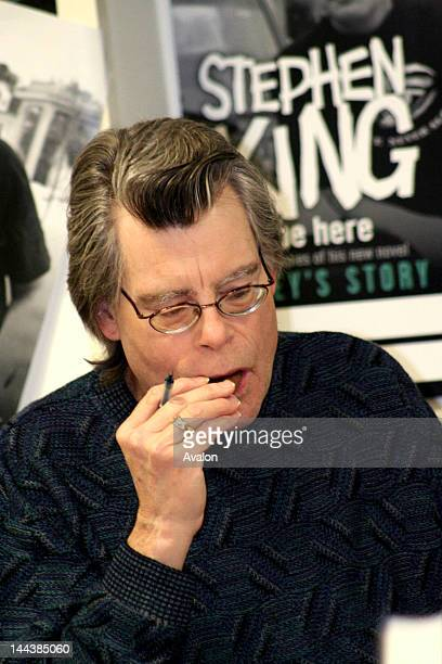 Stephen King during the popular booksigning event at Asda supermarket in Watford England Stephan King eats a biscuit Hundreds of people came some...