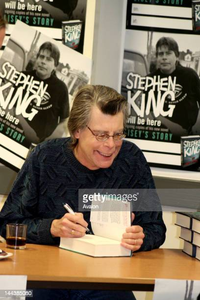 Stephen King during the popular booksigning event at Asda supermarket in Watford EnglandStephan King looks playfully at a young child Hundreds of...