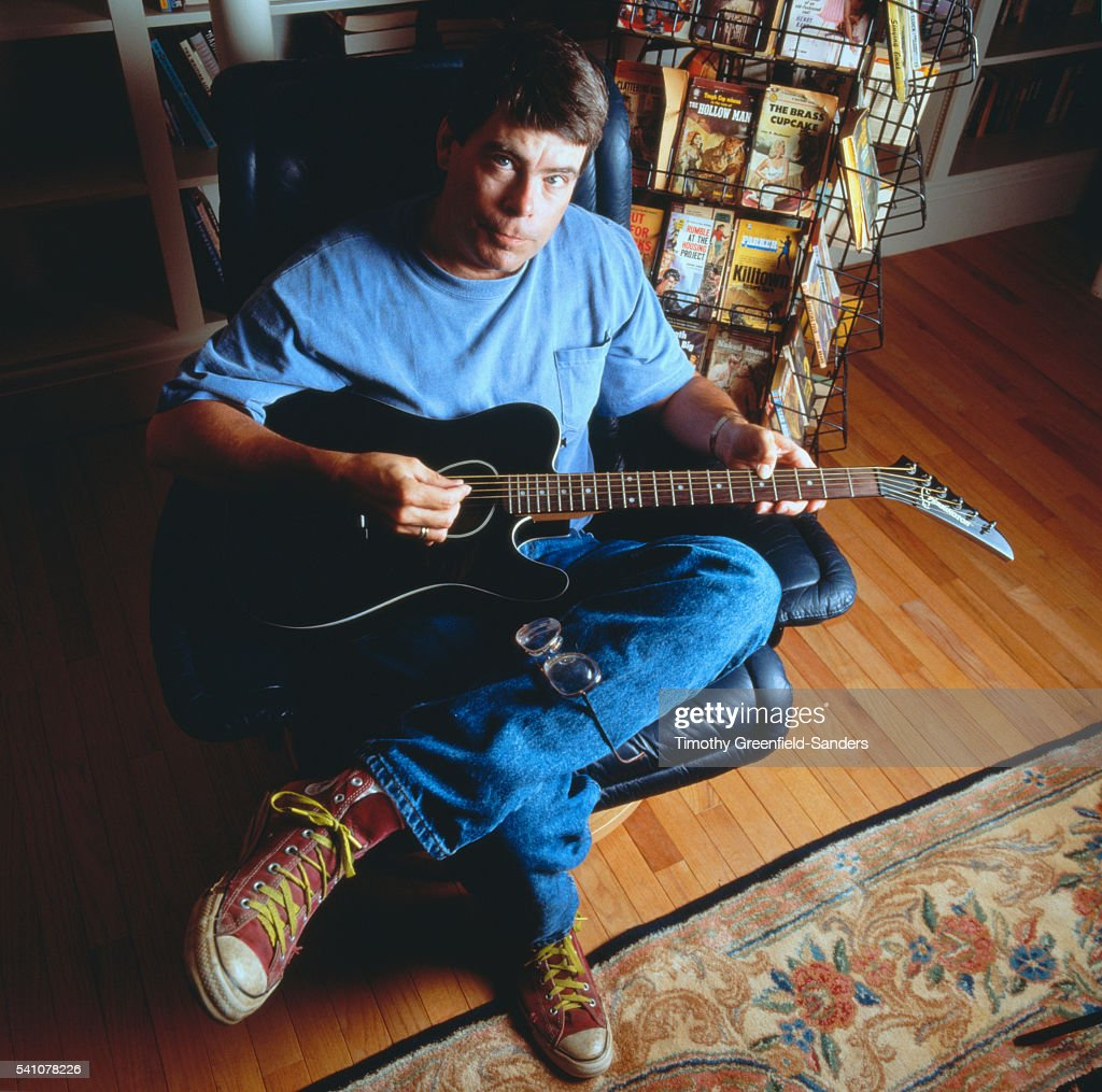 Stephen King Holding Guitar