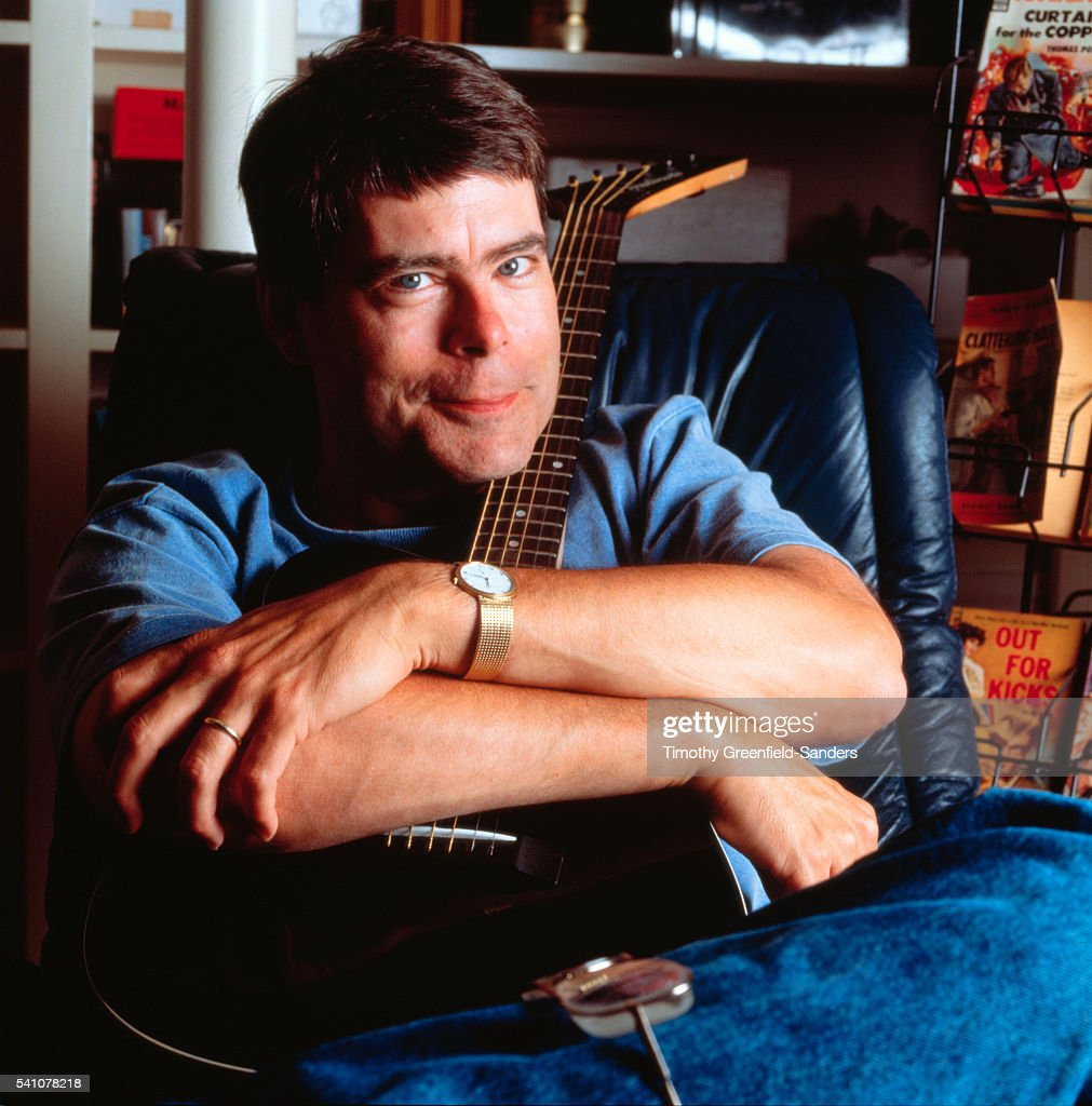 Stephen King Hugging Guitar
