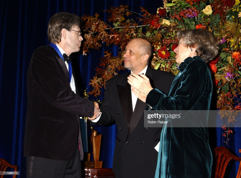 Stephen King, Walter Mosley and Deborah Wiley during The 54th Annual National Book Awards Ceremony and Benefit Dinner at The Marriott Marquis Hotel in New York City, New York, United States.