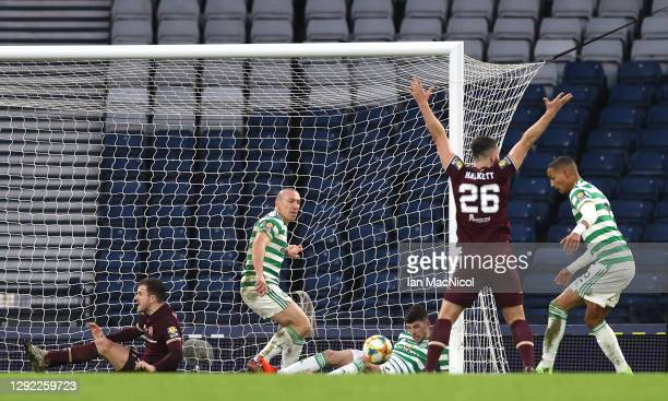 Stephen Kingsley of Heart of Midlothian celebrates after scoring their sides second goal as Ryan Christie and Scott Brown of Celtic look to block the...