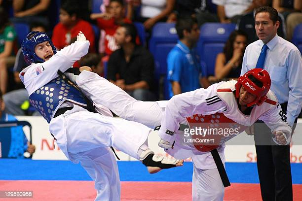 Stephen Lambdin , of USA, and Carlos Canas , of Colombia, in action during the men's taekwondo heavy category as part of the Pan American Games...