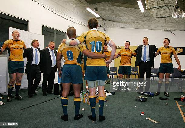Stephen Larkham and George Gregan of the Wallabies sing the Australian National anthem with team mates in their changeroom after wining the 2007 Tri...