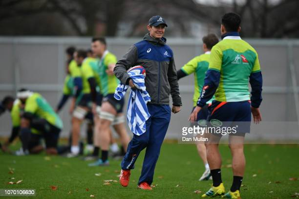 Stephen Larkham Attack Coach of Australia talks with Matt Toomua of Australia during a training session at the Lensbury on November 20 2018 in London...