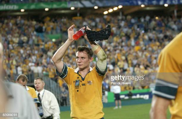 Stephen Larkham of Australia applauds the Fans during the Rugby World Cup Semi Final between Australia and New Zealand at Telstra Stadium on November...