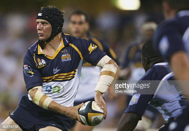Stephen Larkham of the Brumbies looks to pass during the Tooheys New Super 12 match between the Brumbies and the Bulls at Canberra Stadium on March 4...