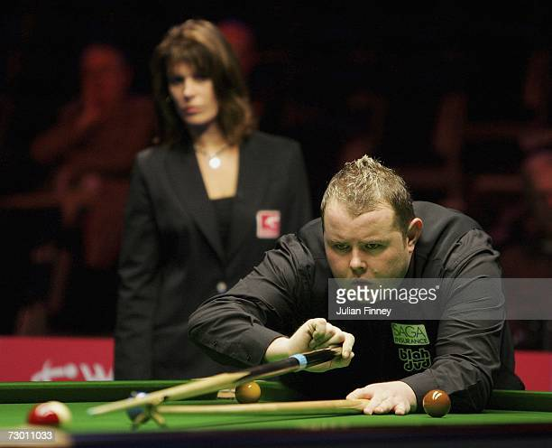 Stephen Lee of England plays a shot as Referee Michaela Tabb watches in his match against Graeme Dott of Scotland during the 2007 Saga Insurance...