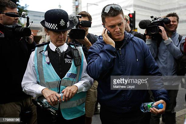 Stephen Lennon aka Tommy Robinson leader of the English Defence League discusses plans with a police liasion officer before the group march to...