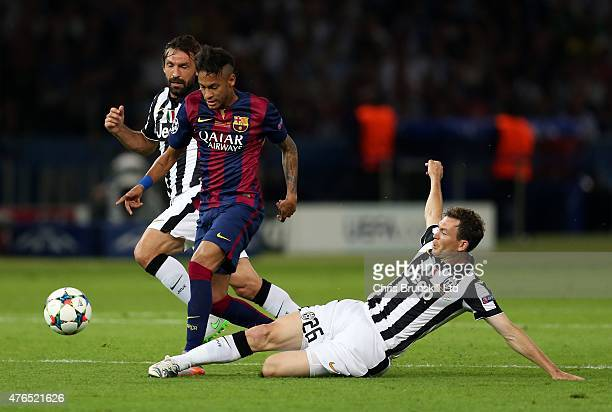 Stephen Lichtsteiner of Juventus tackles Neymar of FC Barcelona during the UEFA Champions League Final match between Juventus and FC Barcelona at the...