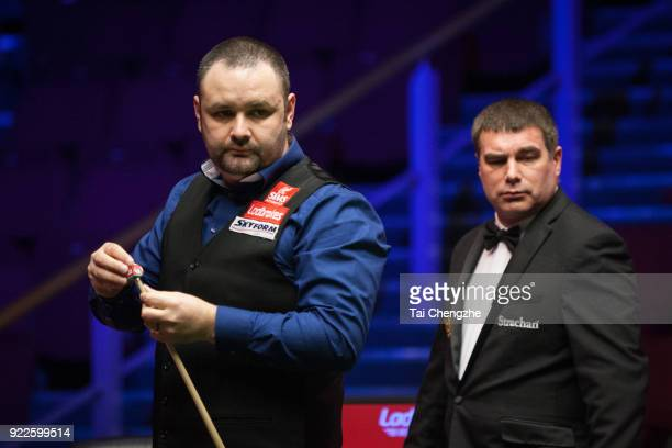 Stephen Maguire of Scotland chalks the cue during his second round match against Michael Georgiou of Cyprus on day three of 2018 Ladbrokes World...