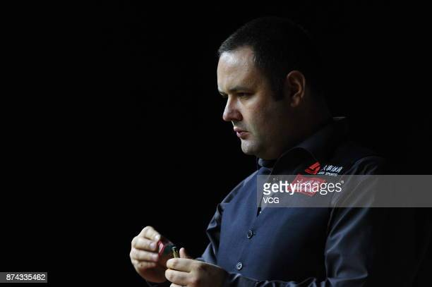 Stephen Maguire of Scotland chalks the cue during the first round match against Rory McLeod of England on day two of 2017 Shanghai Masters at...