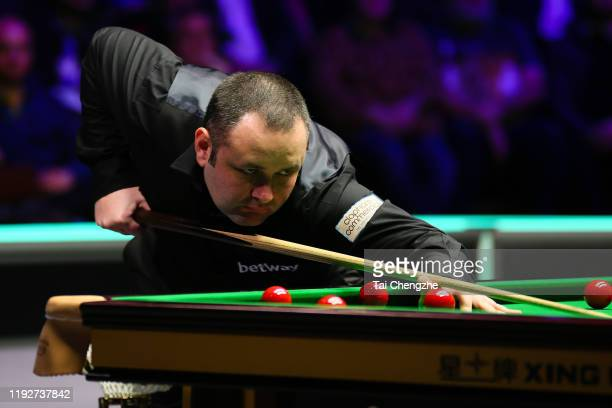 Stephen Maguire of Scotland plays a shot during the final match against Ding Junhui of China on day 13 of 2019 Betway UK Championship at Barbican...