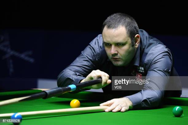 Stephen Maguire of Scotland plays a shot during the first round match against Rory McLeod of England on day two of 2017 Shanghai Masters at Shanghai...