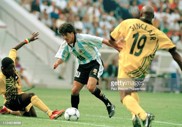 Stephen Malcolm of Jamaica attempts to tackle Ariel Ortega of Argentina during the 1998 FIFA World Cup Group H match at the Parc des Princes on June...