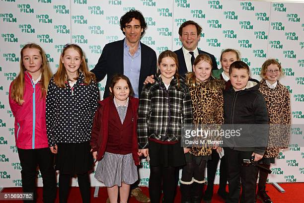 Stephen Mangan and Ed Vaizey MP pose with children at the 2016 Into Film Awards at Odeon Leicester Square on March 15 2016 in London England