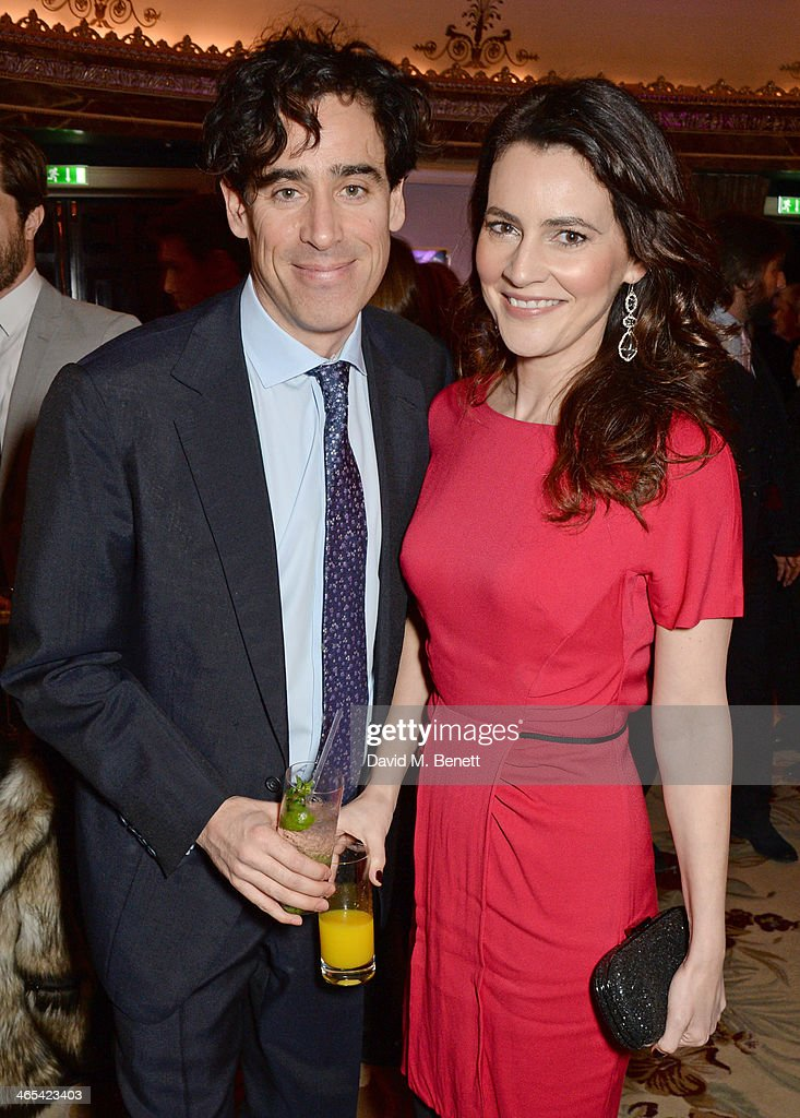 Stephen Mangan (L) and Louise Delamere attend a drinks reception at the South Bank Sky Arts awards at the Dorchester Hotel on January 27, 2014 in London, England.