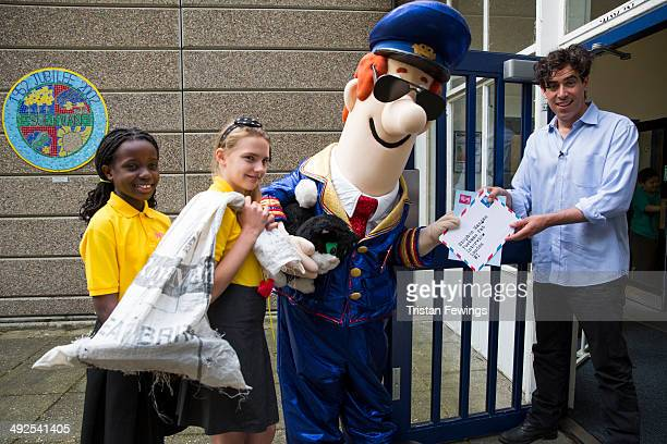 Stephen Mangan visits Sulivan Primary School for a Q A with Postman Pat at Sulivan Primary school on May 21 2014 in London England