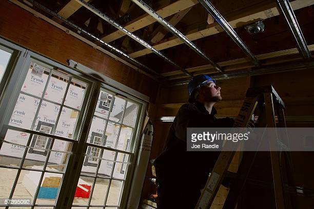 Stephen Masterson an immigrant from Northern Ireland climbs a ladder to install a fire sprinkler system at a construction site April 19 2006 in...