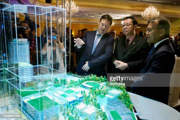 Stephen McCann chief executive officer of LendLease Group left speaks to Lim Guan Eng Malaysia's finance minister center and Azmar Talib chief...