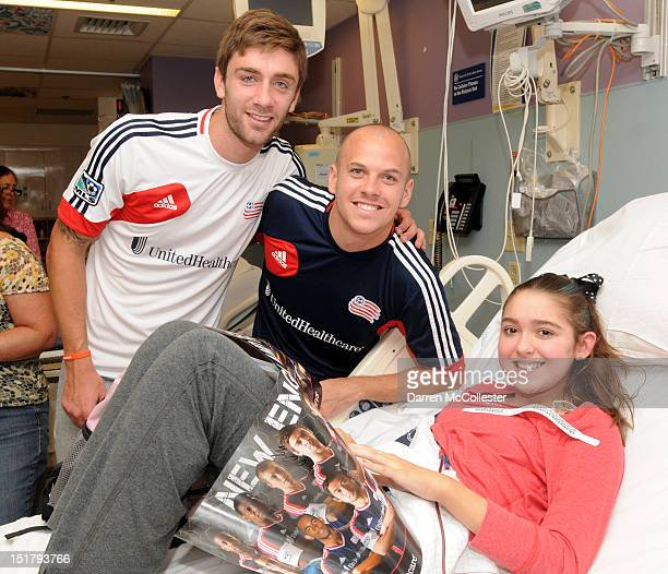Stephen McCarthy and Alec Purdie of the New England Revolution energize with Katelyn at Boston Children's Hospital on September 11 2012 in Boston...