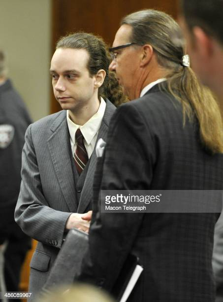 Stephen McDaniel shakes hands with his attorney Franklin Hogue as he walks to the bench Monday morning to enter a guilty plea for murdering Lauren...