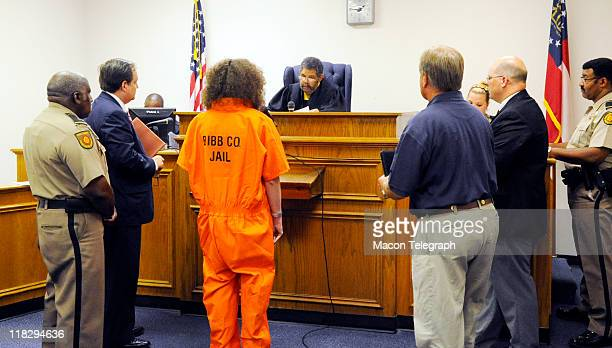 Stephen McDaniel stands before the magistrate at the Bibb County Law Enforcement Center surrounded by Bibb County Bailiffs his attorney Macon Police...