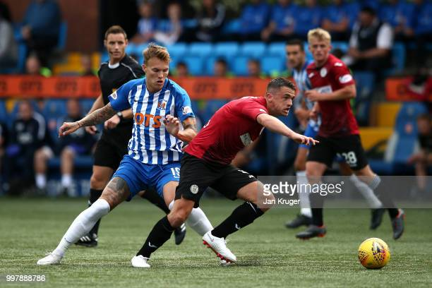 Stephen McGinn of St Mirren controls the ball from Lee Erwin of Kilmarnock FC during the Betfred Scottish League Cup match between Kilmarnock and St...