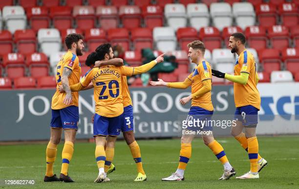 Stephen McLaughlin of Mansfield Town celebrates with team mates Ryan Sweeney, George Maris and Jordan Bowery after scoring their side's first goal...