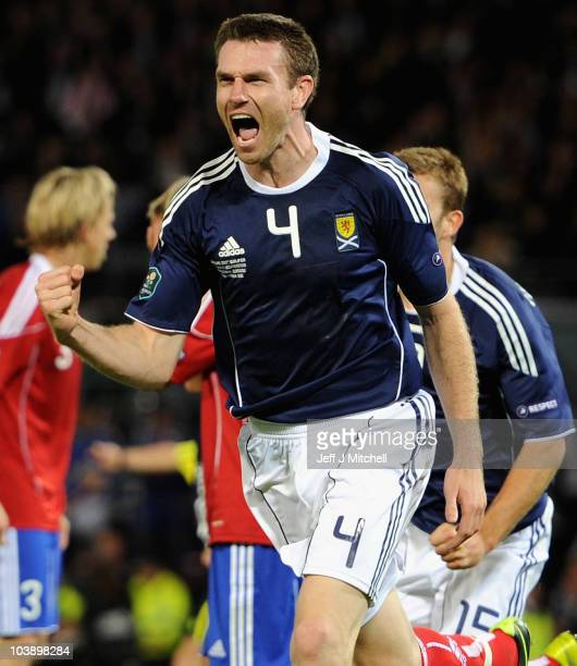 Stephen McManus of Scotland celebrates after scoring the winning goal during the UEFA Euro 2012 Group I Qualifying match between Scotland and...