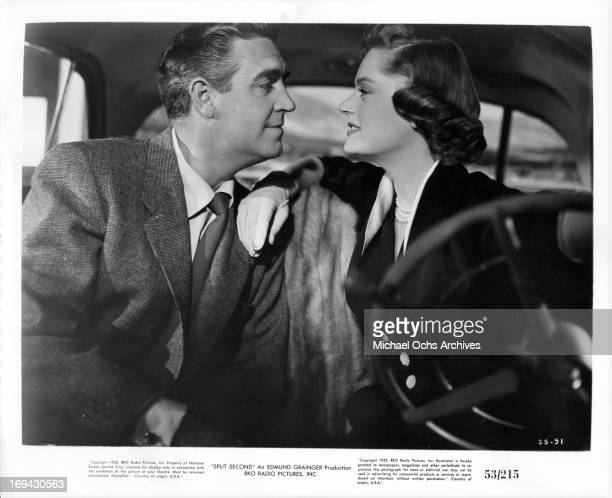 Stephen McNally looking fondly at Alexis Smith in the car in a scene from the film 'Split Second' 1953