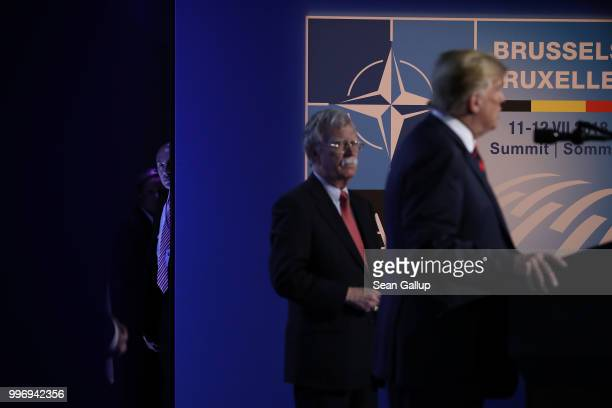 Stephen Miller policy advisor to US President Donald Trump looks on as Trump flanked by National Security Advisor John Bolton speaks to the media at...