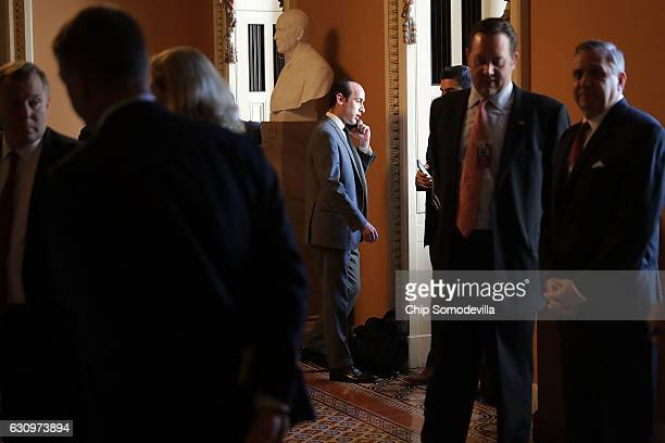 Stephen Miller Senior Adviser to US Presidentelect Donald Trump talks on the phone while waiting outside the Senate Republican policy luncheon at the...
