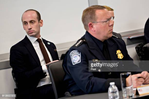 Stephen Miller White House senior advisor for policy left listens during a Customs and Border Protection roundtable discussion with US President...