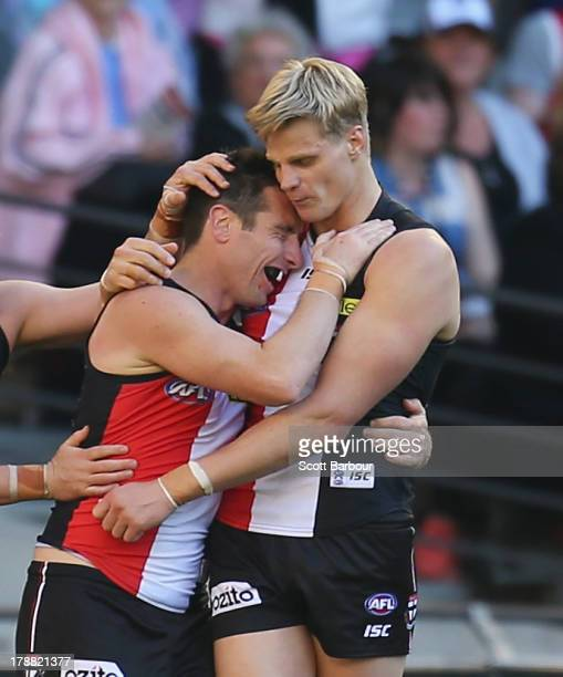 Stephen Milne of the Saints is congratulated by Nick Riewoldt after kicking a goal during the round 23 AFL match between the St Kilda Saints and the...