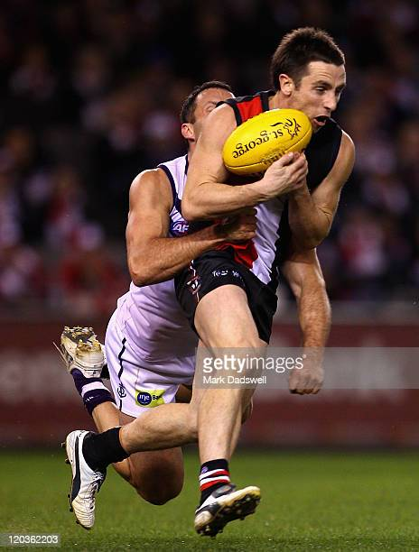 Stephen Milne of the Saints marks in front of Antoni Grover of the Dockers during the round 20 AFL match between the St Kilda Saints and the...