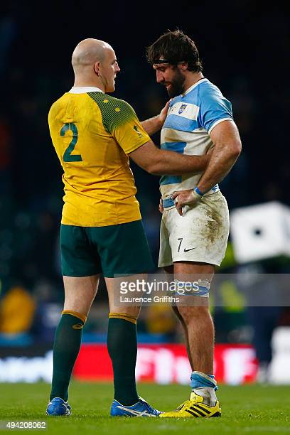 Stephen Moore of Australia consoles Juan Martin Fernandez Lobbe of Argentina at the final whistle during the 2015 Rugby World Cup Semi Final match...