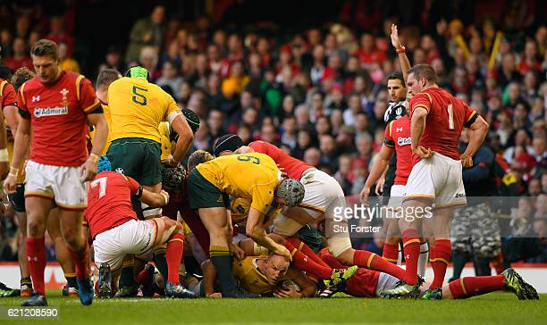 Stephen Moore of Australia is congratulated by teammates after scoring the opening try during the international match between Wales and Australia at...