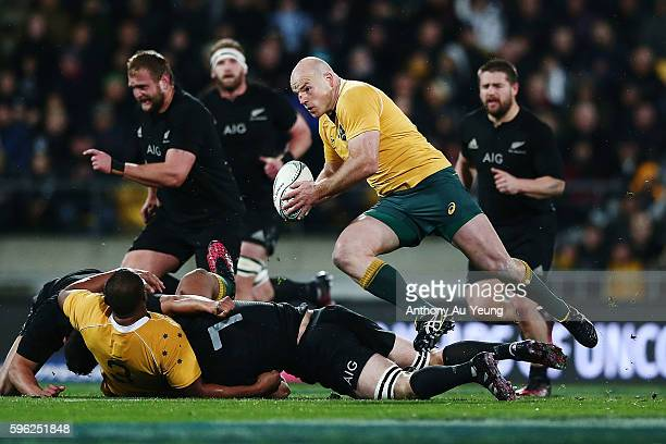Stephen Moore of Australia runs the ball during the Bledisloe Cup Rugby Championship match between the New Zealand All Blacks and the Australia...