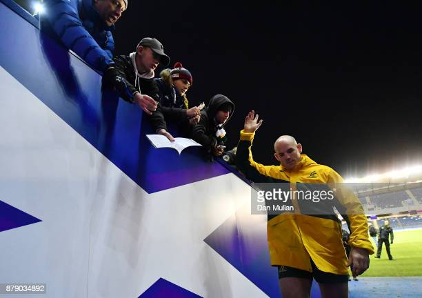 Stephen Moore of Australia waves goodbye as he makes his way down the tunnel following his final test match the International match between Scotland...