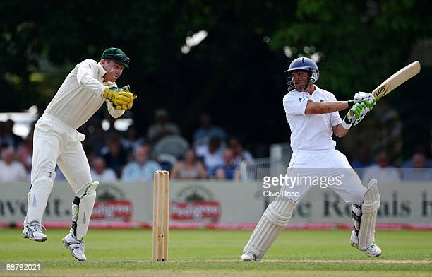 Stephen Moore of England Lions hits out watched by Brad Haddin of Australia during the Ashes warmup match between England Lions and Australia at New...