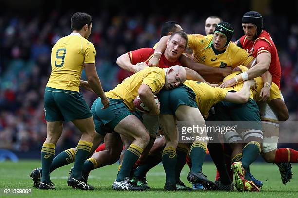 Stephen Moore of the Australian Wallabies passes the ball to scrumhalf Nick Phipps during the International match between Wales and Australia at the...