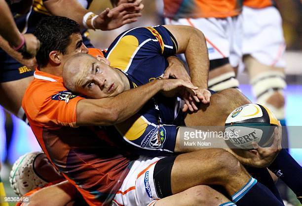 Stephen Moore of the Brumbies looks to offload during the round nine Super 14 match between the Brumbies and the Cheetahs at Canberra Stadium on...
