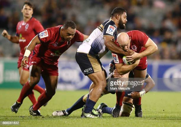 Stephen Moore of the Reds is tackled during the round seven Super Rugby match between the Brumbies and the Reds at GIO Stadium on April 8 2017 in...