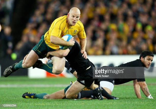 Stephen Moore of the Wallabies is tackled during the 2010 TriNations Bledisloe Cup match between the Australian Wallabies and the New Zealand All...